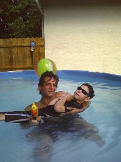Pool, squirtguns, my shades, and Grandpa (3). AWESOME!